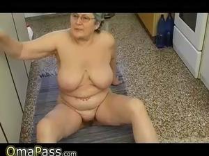 Big titted milf in kitchen